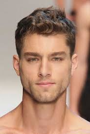 good blonde haircut for men with curly light hair