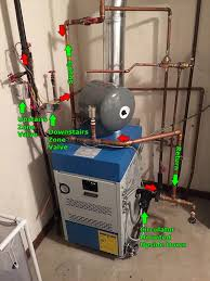 taco cartridge circulator installed backwards water hammer on this is the new boiler install the green arrows being the intended setup but the red arrows are the current flow because of the pump being installed