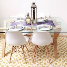 scandinavian style dining area john lewis oak and gl dining table white eames chairs the john lewis accessories and ikea rug add a splash of colour