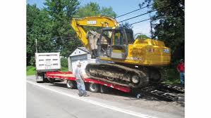 what to know before using a dump truck to tow equipment rogers bros schwartz constr10797019 544ee94faf095 dump trucks