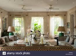open double door drawing. Matching Lamps And Open Doors In Drawing Room Of Leamington House Villa, Barbados - Stock Double Door
