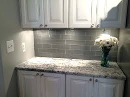 grey subway tile backsplash with dark cabinets light glass white grout
