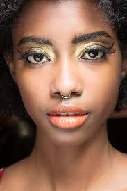 gold eyeshadow and orange lipstick