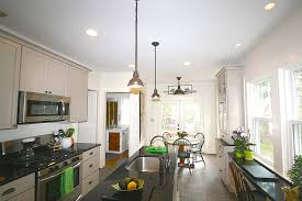 lighting in the kitchen includes the natural light provided by the double window and patio doors