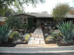 Front yard landscape - large custom concrete pavers, xeriscape, native  plantings, large boulders