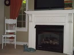 old painted fireplace mantel pictures the antique mantel fronts a gas fireplace