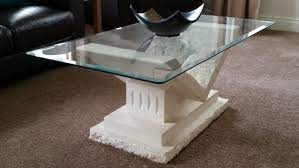 stone base glass top coffee table for