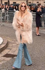 retro poppy delevingne stepped back in time on wednesday when she arrived at the miu