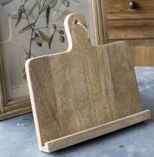 keep your hands and your counter space free while assembling your favorite dishes with this wooden cookbook holder clean lines and soft warmth come