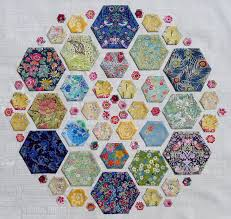 Cabbage Quilts: September 2012 & This mini quilt was a lot of fun to make. I made up 5 different sized card  hexagon templates from size 1/2 inch up to 2 1/2 inches. Adamdwight.com