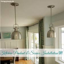 installing our new kitchen lighting sconces and pendants from build com at thehappyhousie com