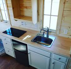 tiny house sink. All Five Tiny House RVs Are Fully Insulated With Upstairs And Downstairs Sleeping Spaces, Kitchenettes, Bathrooms The Creature Comforts Of Home. Sink R