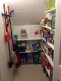 Under stairs coat closet turned pantry. I would turn it into storage for  cleaning items instead of a pantry.