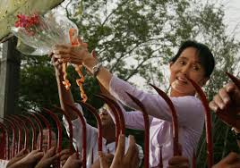 aung san suu kyi focused on family and a ph d before fighting for aung san suu kyi holds a bouquet of flowers as she appears at the gate of