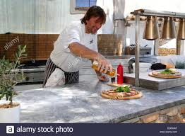 Making An Outdoor Kitchen Making Pizza In Alfresco Outdoor Kitchen Stock Photo Royalty Free