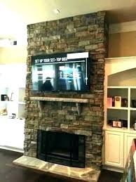 tv over gas fireplace hanging over fireplace hanging over fireplace wall mount hang mounting a flat
