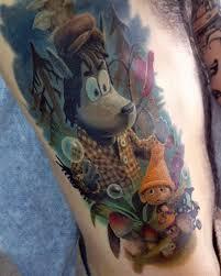 цветная татуировка на плече парня мультфильм про волка фото
