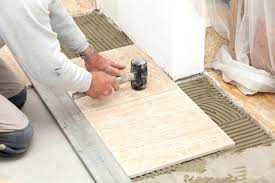 thinset for wall tile use a rubber mallet to seat tile firmly in the base of thinset for wall tile