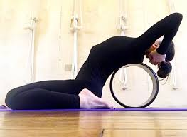 5 yoga wheel moves that will help you