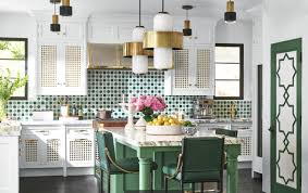 the true centerpiece of martyn s stunning abode is a beautifully crafted and boldly colored kitchen with breathtaking views of a fantasy garden