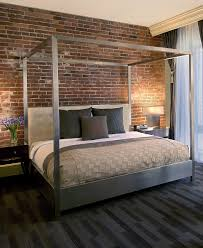 Urban Bedroom Decor Metal Canopy Bed Against Red Brick Wall At