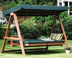 View in gallery Gorgeous green swing bed in the backyard with shade