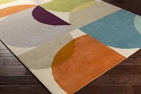 orange and teal area rug
