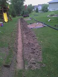 picture of fill trench with pea gravel quarter minus