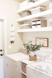 diy laundry room shelves and shiplap wall