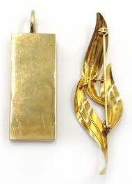 9ct gold ingot pendant hallmarked 30gm and a 9ct gold leaf brooch hallmarked 2gm