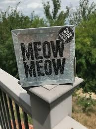 bright cat themed metal wall art