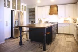 dark blue kitch island breakfast table white kitchen cabinets