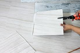 tile over concrete floor cutting l and stick vinyl tile concrete floors vs tile floors cost