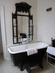 Bathroom: Black Tub With Skull Wallpaper - Black Bathtub