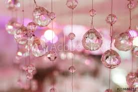 chandelier light in interior chrystals close up crystal part from chandelier pink