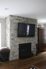stone fireplaces with flat screen tvs mounted above are a great way to combine two focal points into one and save space in the last six years of installing