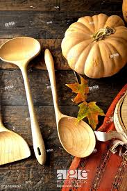 stock photo fall diner celebration in the country wooden spoons with leaves and pumpkin