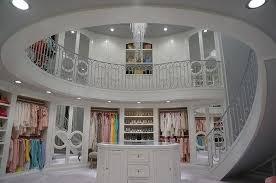 two story walk in closets at luxury closet spiral staircase mirrored bi fold doors bag shelves