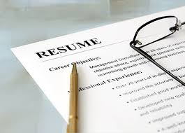 Image of a pen and glasses on a Resume