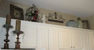 decorate space above your kitchen cabinetry baer home