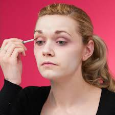 apply black white face paint eye makeup