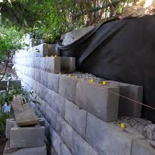 large segmental retaining walls are constructed using precast concrete blocks that weigh in excess of 100 lbs each these blocks come in a variety of shapes