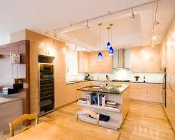 kitchen rail lighting. Inspiring Modern Kitchen Wooden Laminate Floor And Kitcehn Island With Marble Countertop Rail Lighting Plus Blue Pendant S