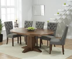 lovely dining table with grey chairs mark harris turin solid dark oak round extending dining