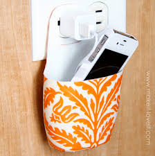 holder for charging cell phone made from lotion bottle make it and love it