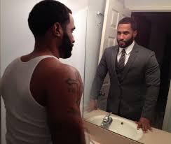 black man looking in mirror. the man in mirror black looking sidney malone