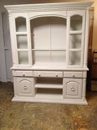 furniture white wooden tv cabinet with doors and drawers plus racks on brown tile floor