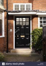 black front doorTraditional Black front door of redbrick house Kingsmead UK