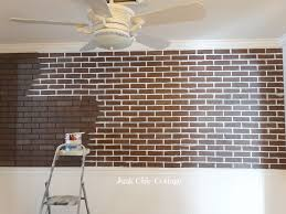 after terry cut and ed the panels to the wall with a nail i began to paint all the grout lines from black to white just used white latex paint i