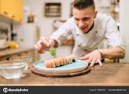 Sushi Cook Smiling Male Cook Decorating Sushi Roll Blue Plate